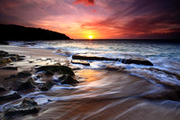Sunset from Kepuhi Beach as large waves wash over  Molokai Hawaii