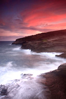 Colorful sunset and big waves crashing on Ka Iwi Coastline Oahu Hawaii