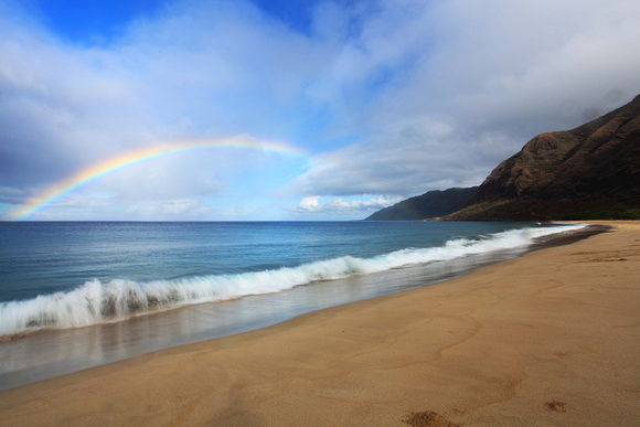 Vibrant rainbow over Makua Bay on Oahu Hawaii