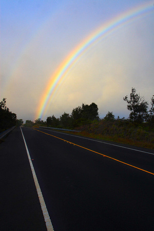 Rainbow Kilauea Volcano sunset Big Island Hawaii